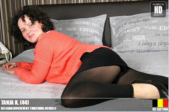 Belgian_Housewife_Fingering_Herself.png